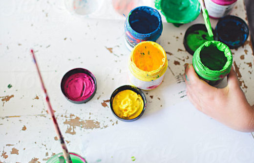 paint bottles of several colors on white background